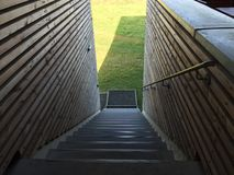 Stairs in a modern building. Stairs in a building, aside some wooden planks stock image