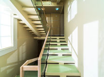 Stairs in modern home interior. Glass and wooden stairs in modern home interior Stock Images