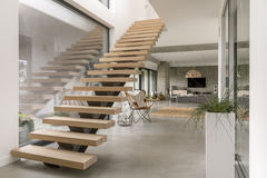 Stairs in modern villa. Minimalistic stairs in modern villa interior royalty free stock image