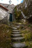 Stairs in Monsanto village Portugal. Rocks, moss and doors of Monsanto village in Portugal Royalty Free Stock Photos