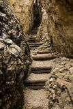 Stairs. In a narrow rocky passage Stock Images