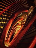 Stairs at the national grand theatre in Beijing. Winding down red armrests and yellow lights stock photos