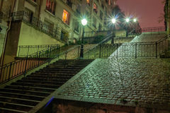 Stairs at night, in the Sacre-Coeur region, Paris, France. Royalty Free Stock Photo