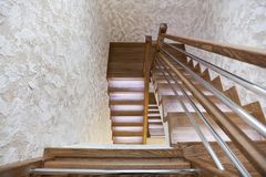 Stairs of oak with illumination and decorative plaster on the walls stock image