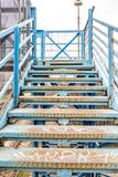 Stairs on old blue bridge Royalty Free Stock Image