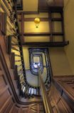 Stairs in Old House 5. Wood Carved Stairs in Old House looking up to ceiling Royalty Free Stock Images