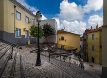 Stairs of the old Lisbon. Portugal. As in Lisbon, clothes are dried. Simple life without a beauty. Paving stone on the streets of the city. Lanes and gateways stock photos