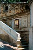 Stairs of the old monastery with the icon. On the wall royalty free stock image