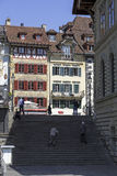 Stairs and the old town buildings. LUCERNE, SWITZERLAND - MAY 08, 2016: Stairs that lead to the square in the old town. Facades of two historic buildings can be royalty free stock photography