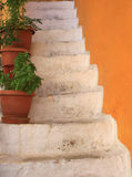 Stairs and orange wall in Greece Royalty Free Stock Photography