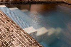 Stairs in a pool Stock Photography