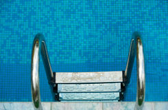 Stairs in the pool Royalty Free Stock Photos
