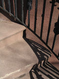 Stairs and rail with shadow. Stairs with decorative iron banister and shadows stock images