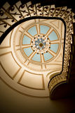 Stairs rails and chandelier on ceiling with geometric art Royalty Free Stock Image