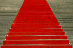 Stairs with red carpet Stock Images