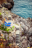 Stairs on the rock to Mediterranean sea Stock Image