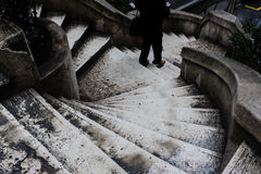 Stairs. Round stairs with person walking down while checking smartphone Royalty Free Stock Photo