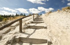 Stairs on sand to blue sky with clouds Royalty Free Stock Photography