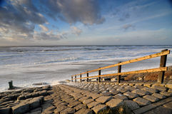 Stairs at seaside in Holland Stock Images