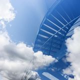 Stairs seem to lead into the clouds in blue sky stock photography