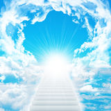 Stairs in sky with clouds and sun. Concept background Stock Images