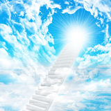 Stairs in sky with clouds and sun Royalty Free Stock Images