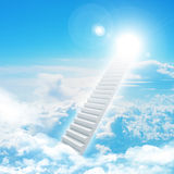 Stairs in sky with clouds and sun Stock Photo