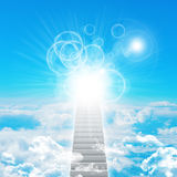 Stairs in sky with clouds and sun Royalty Free Stock Photos