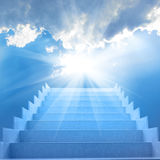 Stairs in the sky. Stairs in sky. Concept with staircase, sun, white clouds and blue background Stock Images