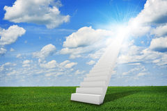 Stairs in sky with green grass, clouds and sun Stock Photography