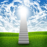 Stairs in sky with green grass, clouds and sun Stock Image