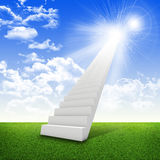 Stairs in sky with green grass, clouds and sun. Concept background Royalty Free Stock Images