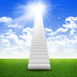 Stairs in sky with green grass, clouds and sun. Concept background Royalty Free Stock Photography