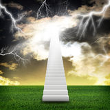 Stairs in sky with green grass and thunderstorm Royalty Free Stock Images