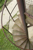 Stairs. Spiral metal stairs with grass and concrete below Stock Images