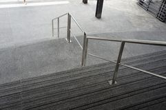 Stairs with Stainless steel railing royalty free stock photography