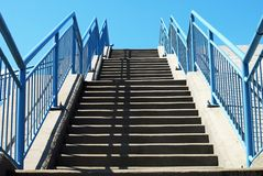 Stairs. A stairway, staircase, stairwell, flight of stairs, or simply stairs is a construction designed to bridge a large vertical distance by dividing it into stock photography