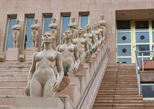 Stairs with statute of naked ladies Stock Image