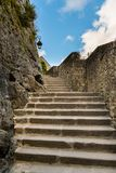 Stairs and stone walls in Le Mont Saint Michelle stock image
