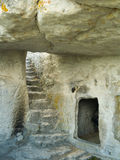 Stairs in stony cave house Stock Photography