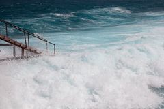 Stairs and storm sea foam Royalty Free Stock Image