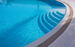 Stairs swimming pool. Summer swimming pool with blue water Stock Images