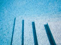 Stairs in swimming pool. royalty free stock images