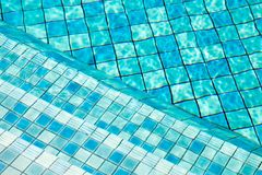 Stairs in swimming pool, Blue tile background. Stairs in swimming pool, Blue background stock photos