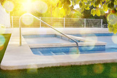 Stairs of a swimming pool in garden Stock Images