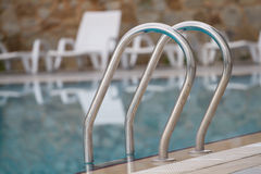 Stairs in  swimming pool Royalty Free Stock Image