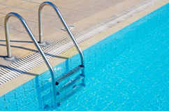 Stairs in swimming pool Royalty Free Stock Photo