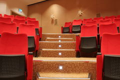 Stairs in theatre. With red empty chairs Stock Photo