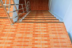 Stairs tile orange walkway down. select focus with shallow depth of field.  royalty free stock images