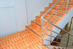 Stairs tile orange walkway down. select focus with shallow depth of field.  stock image
